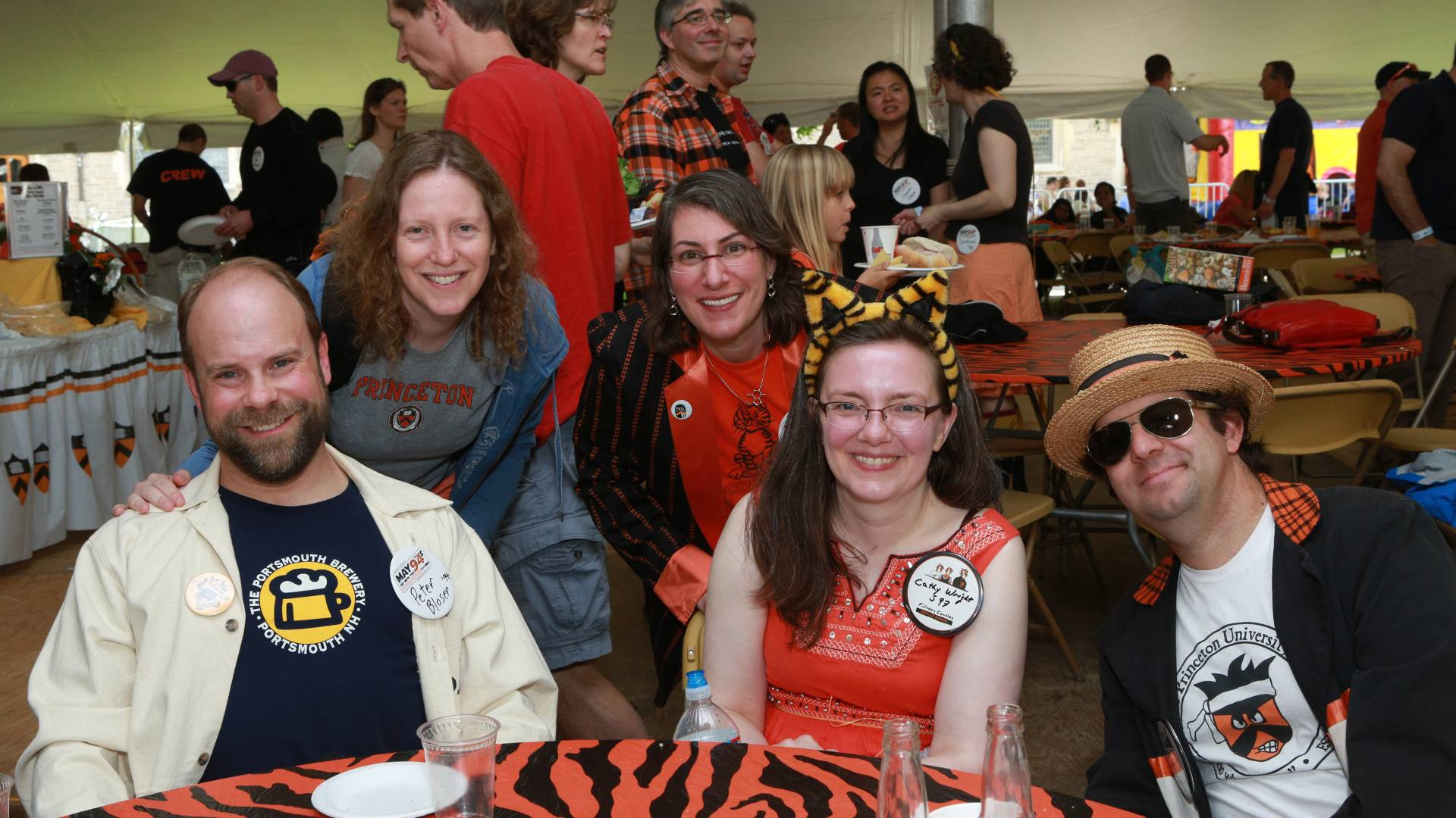 Photo of friends and families at reunions posing at table