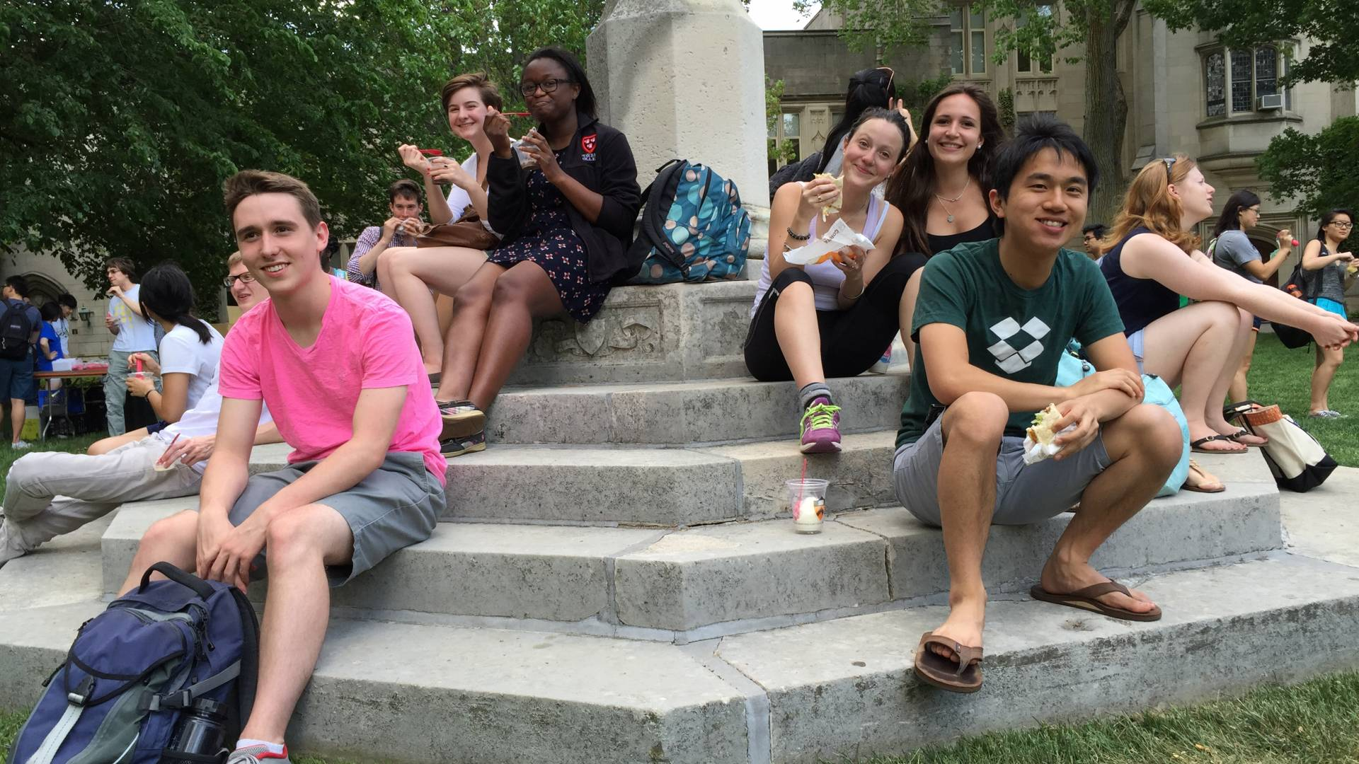 Students sitting and eating at Mather sundial
