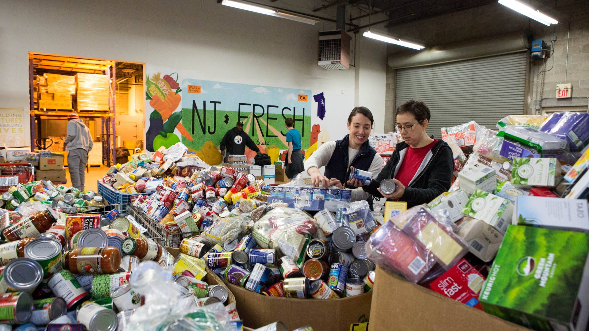 Princeton University staff sort items at Mercer St Friends Food Bank