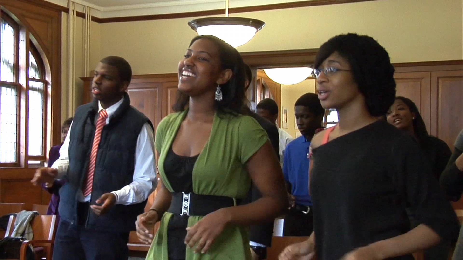 Students singing in Murray Dodge Hall