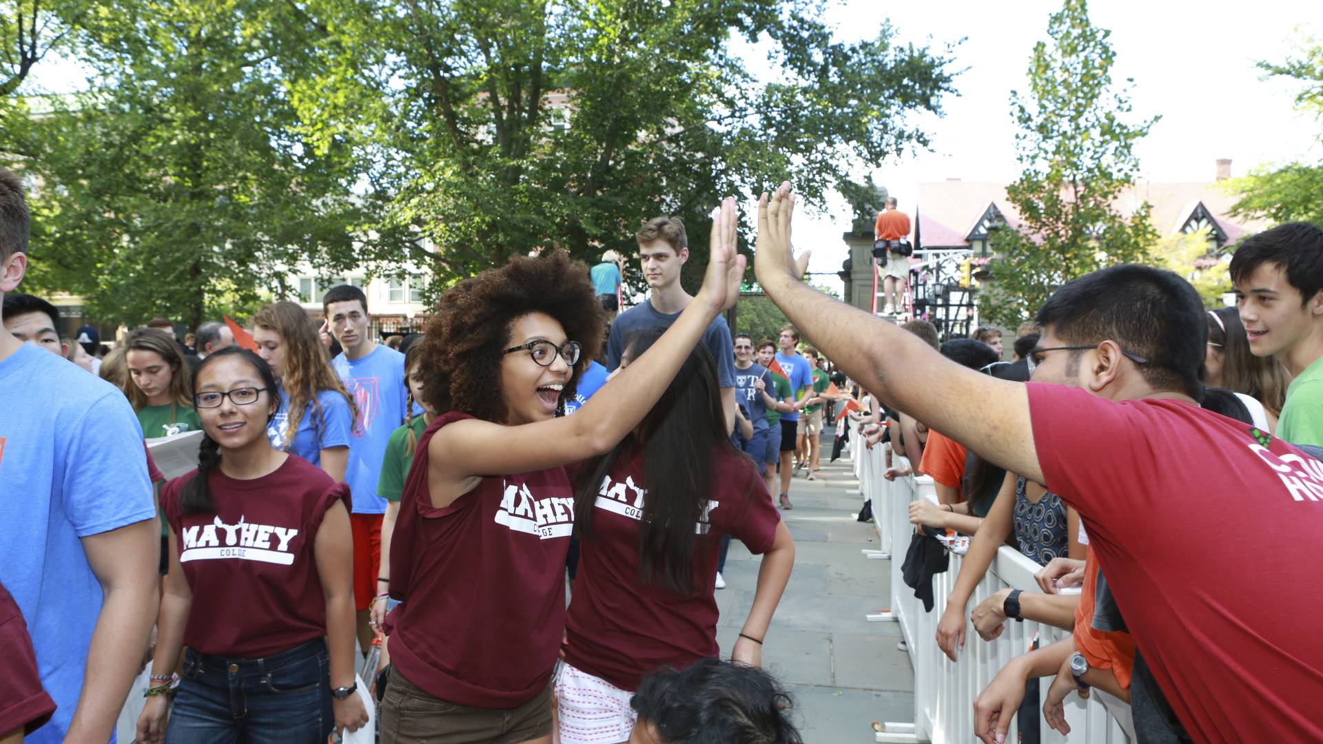 Students hi-five at Opening Exercises Pre-Rade