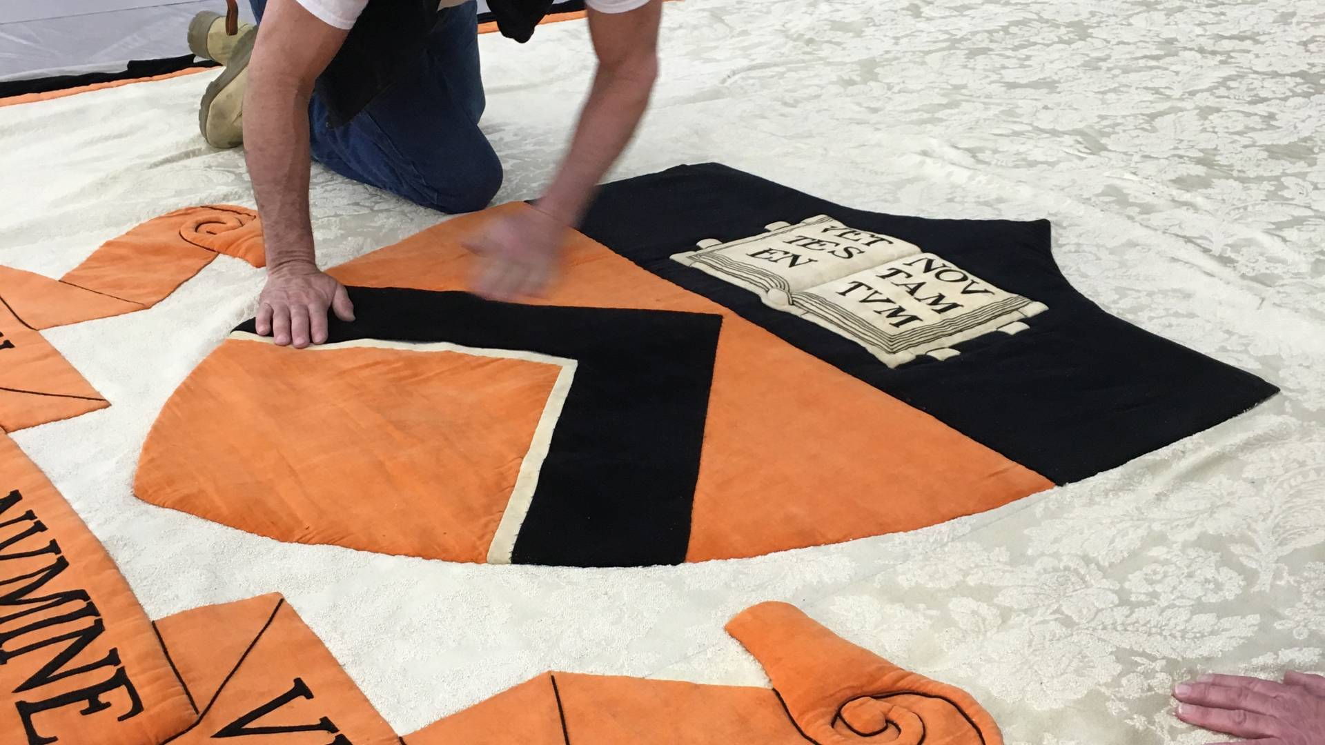 man cleaning Princeton banner