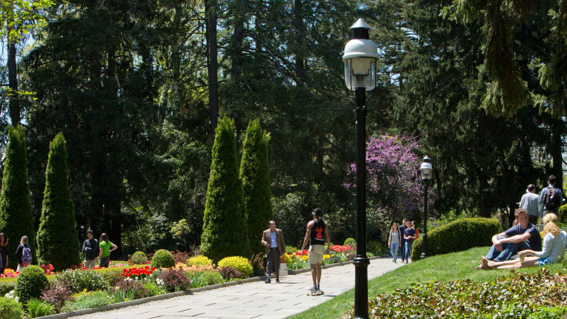 Students walking through Prospect Gardens in the Spring