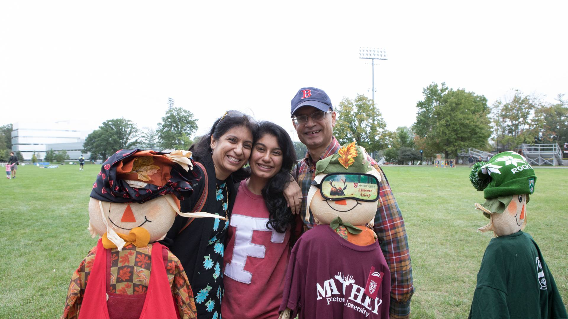 Vrinda Madan and her parents, Alka Madan and Atul Madan on Poe Field
