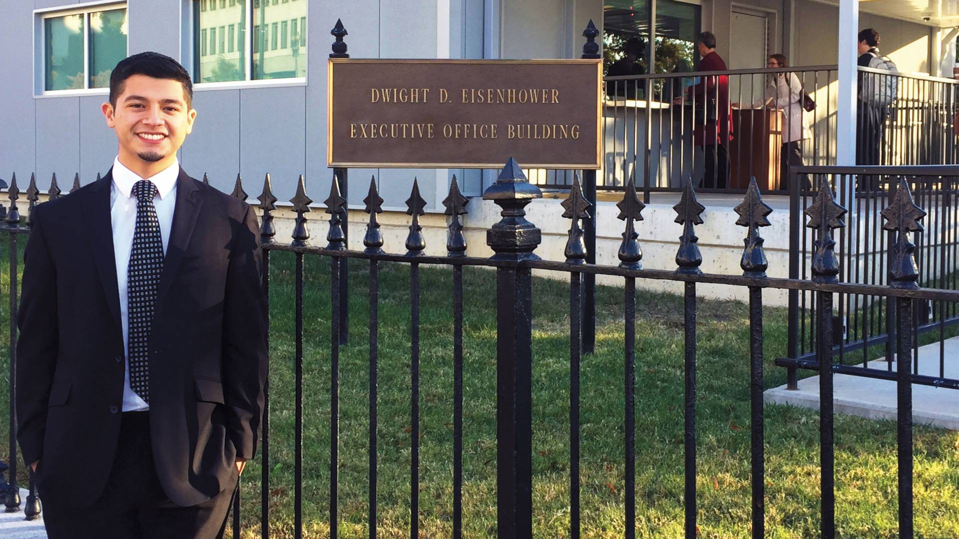 Luis Carchi standing outside Dwight D. Eisenhower building