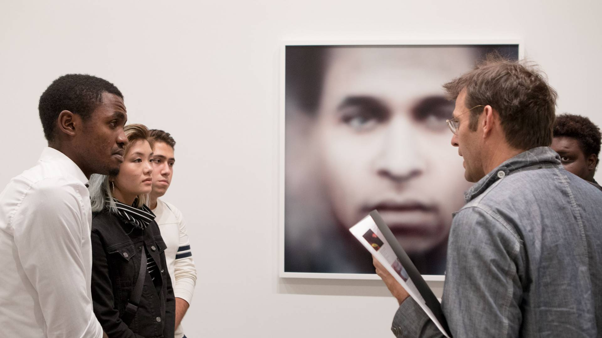 Professor Whetstone discusses photo with students at New York gallery