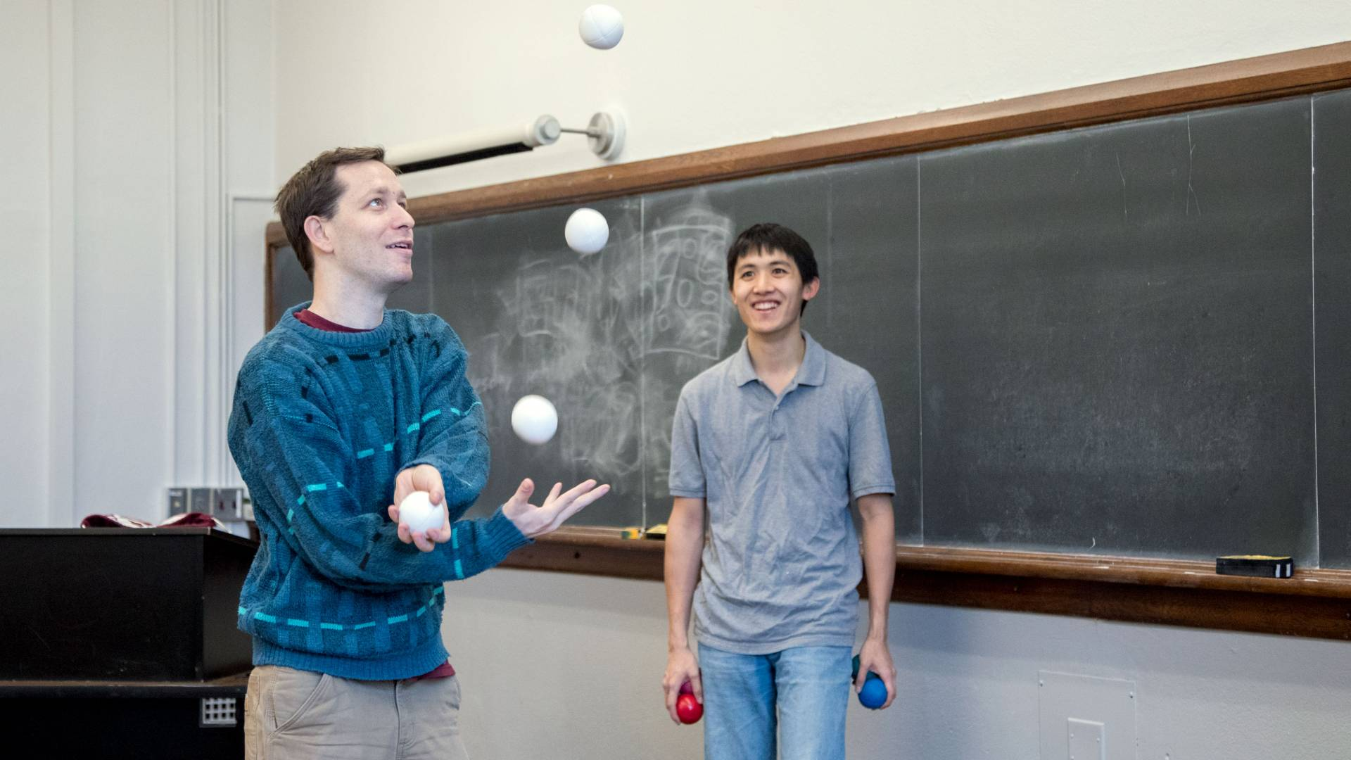 Students juggling in classroom