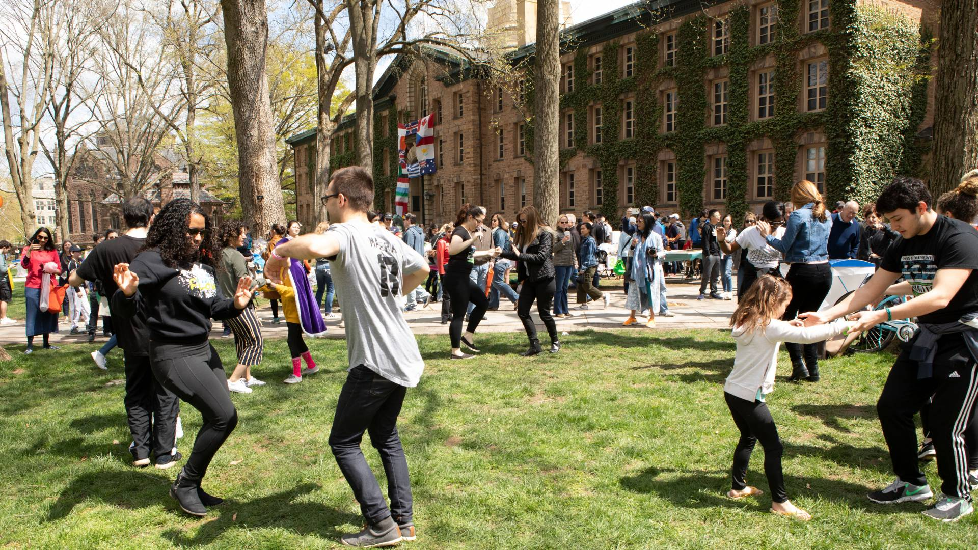 Mas Flow dance group leading dancers on Nassau Hall front lawn