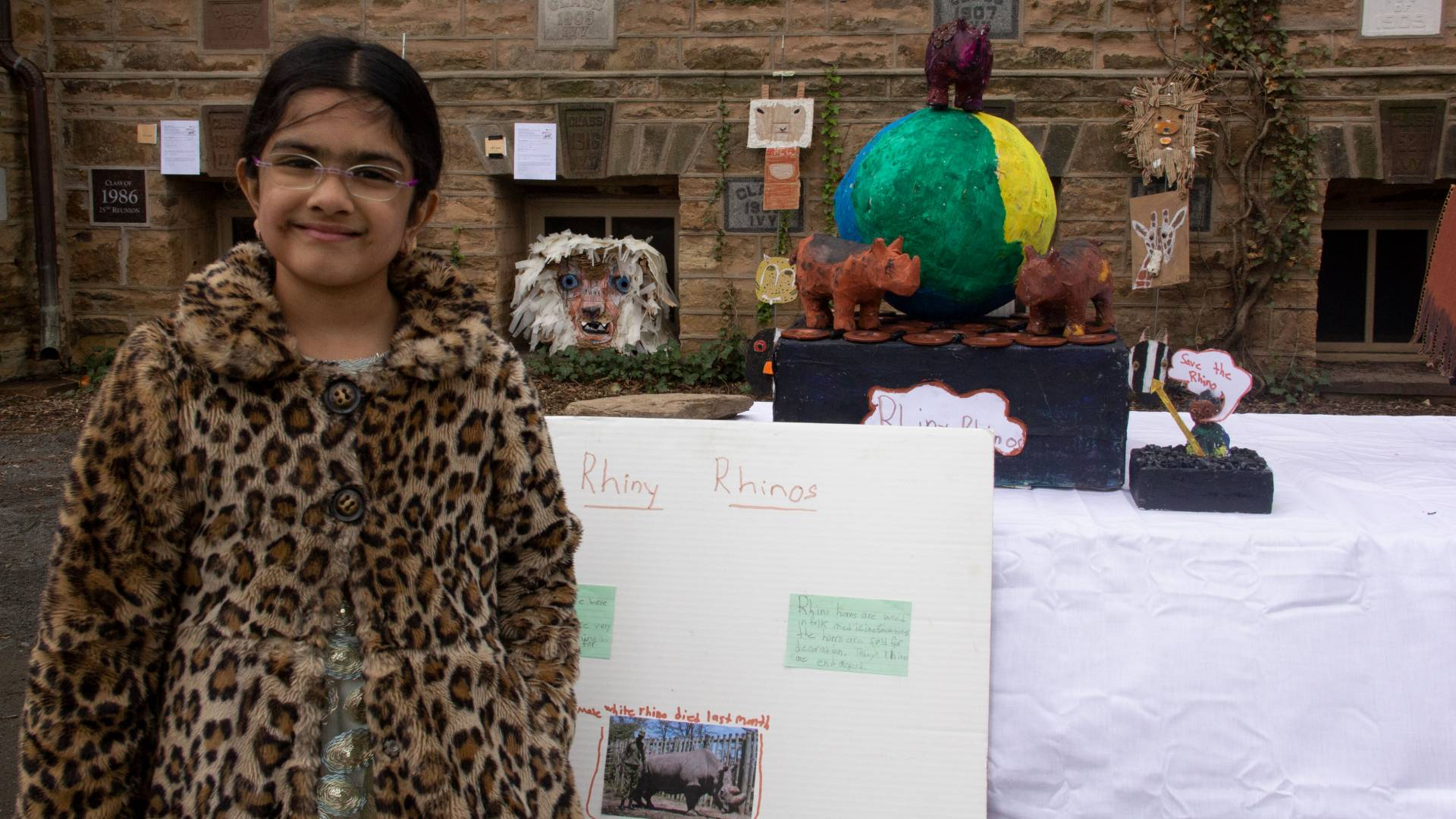 "Ryka Iyer standing in front of her ""Rhiny"" Rhinos trash art piece"