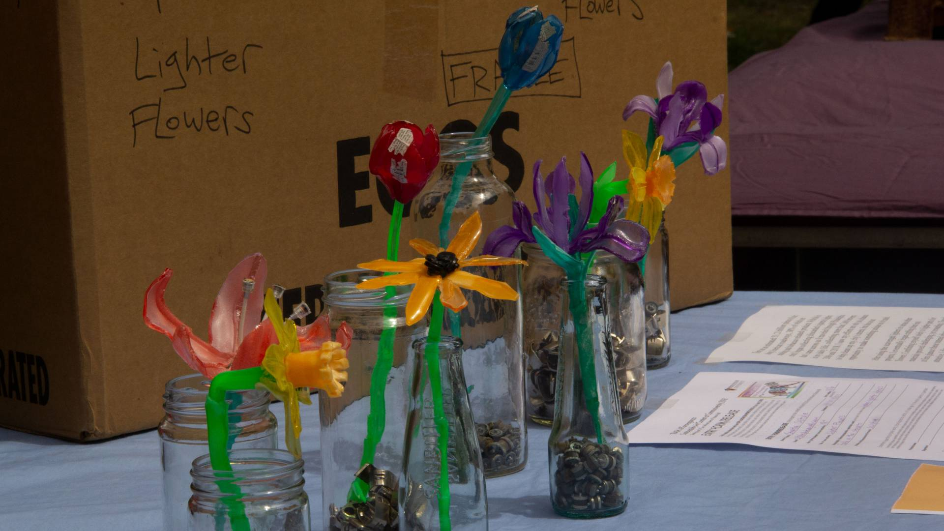 Flowers made from cigarette lighters for trash art competition