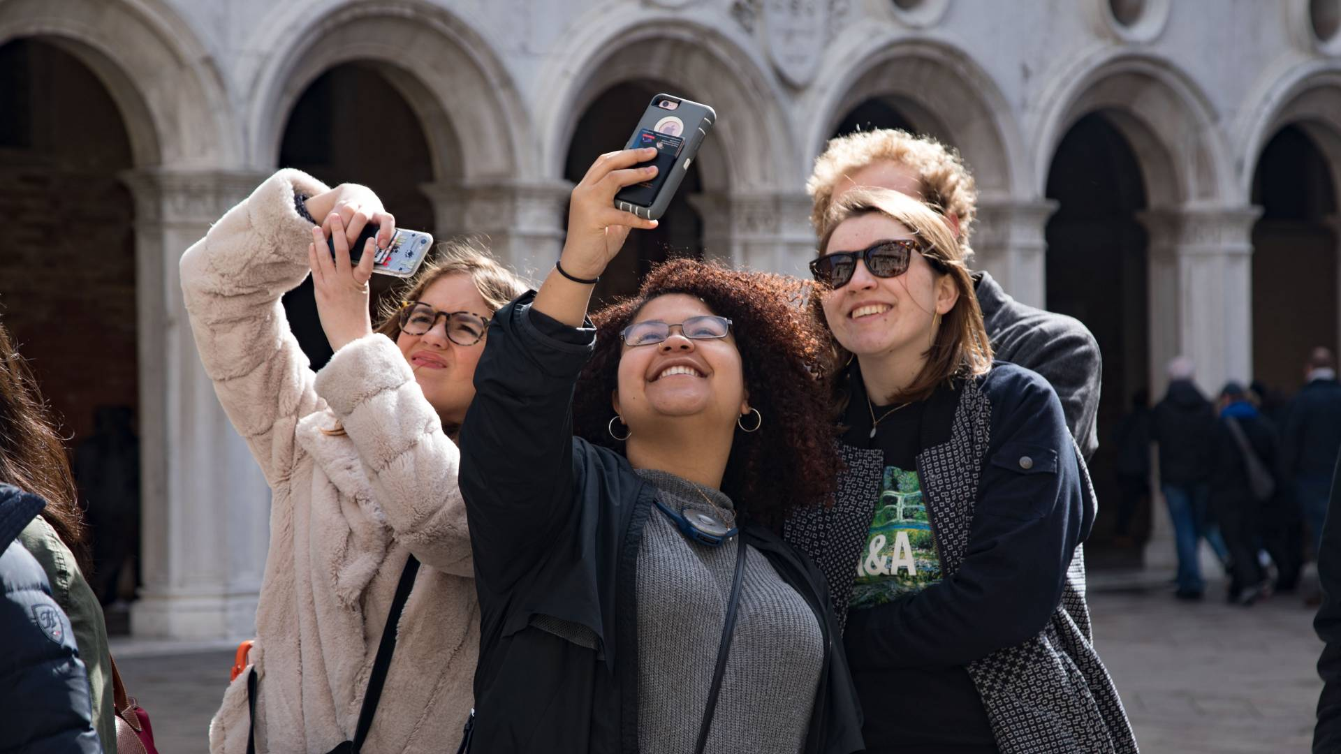 Students taking selfies outside the Doge's Palace in Venice