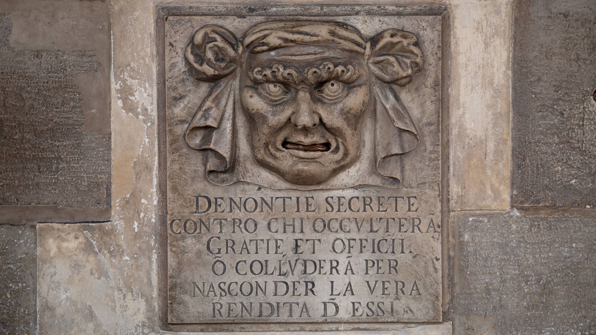 Detail of face on wall of Doge's Palace in Venice