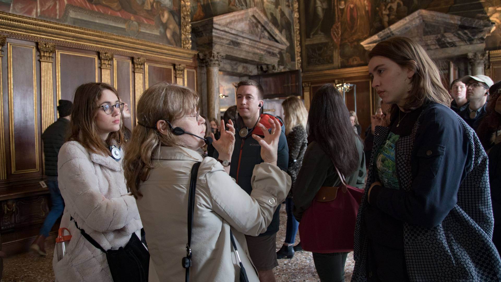 Tour guide with students inside the Doge's Palace in Venice