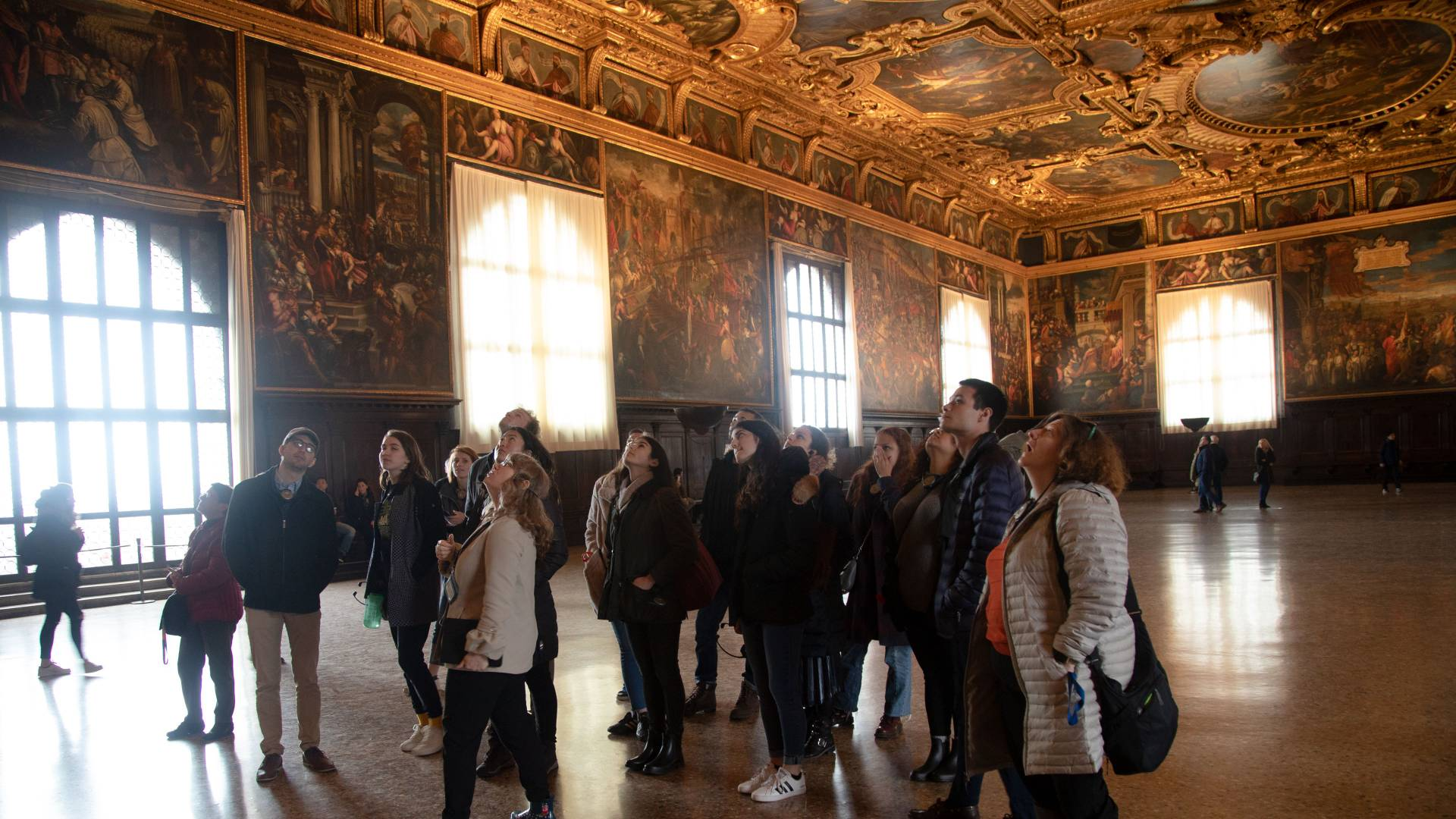 Students looking up at ceiling in Doge's Palace in Venice