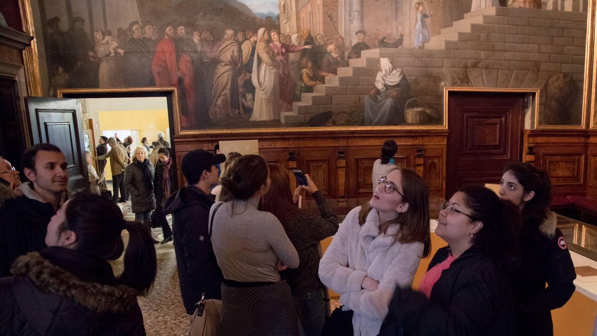 Students looking up at artwork in Gallerie dell'Accademia in Venice