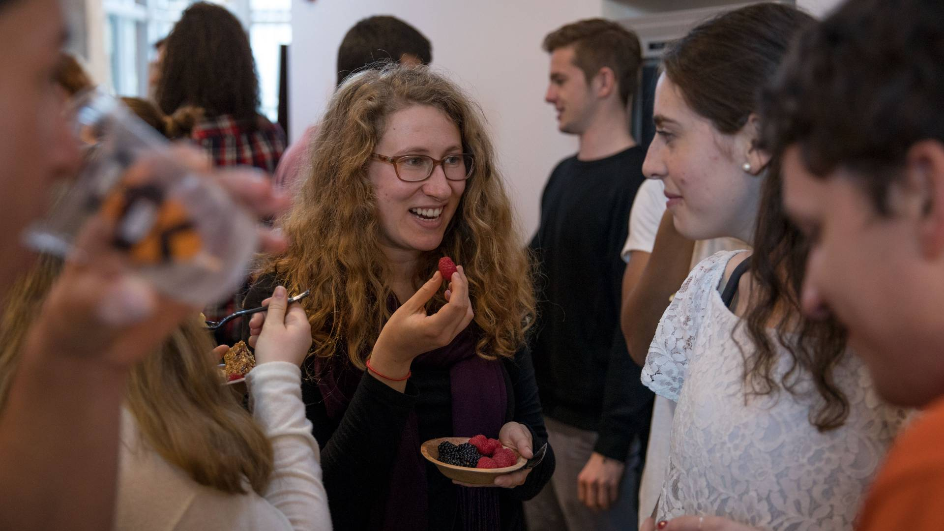 Students talking and eating berries