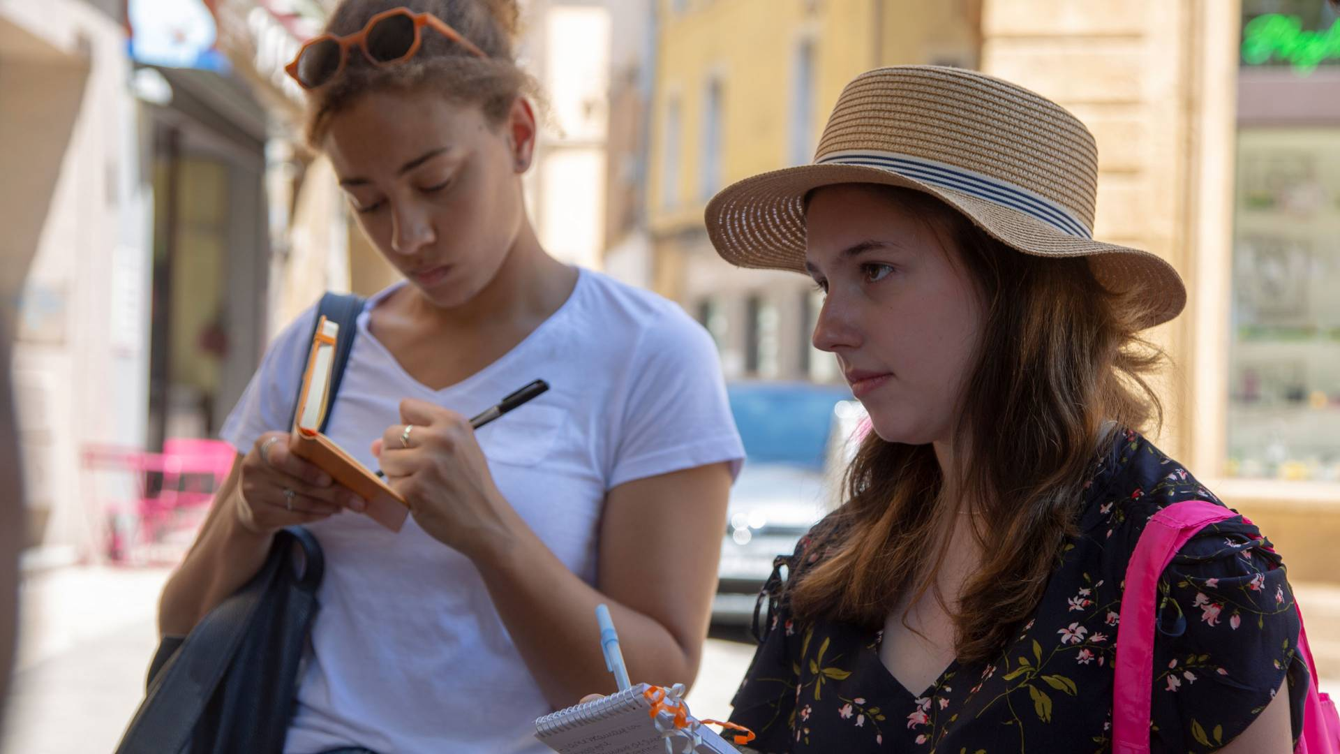 Two students taking notes in France