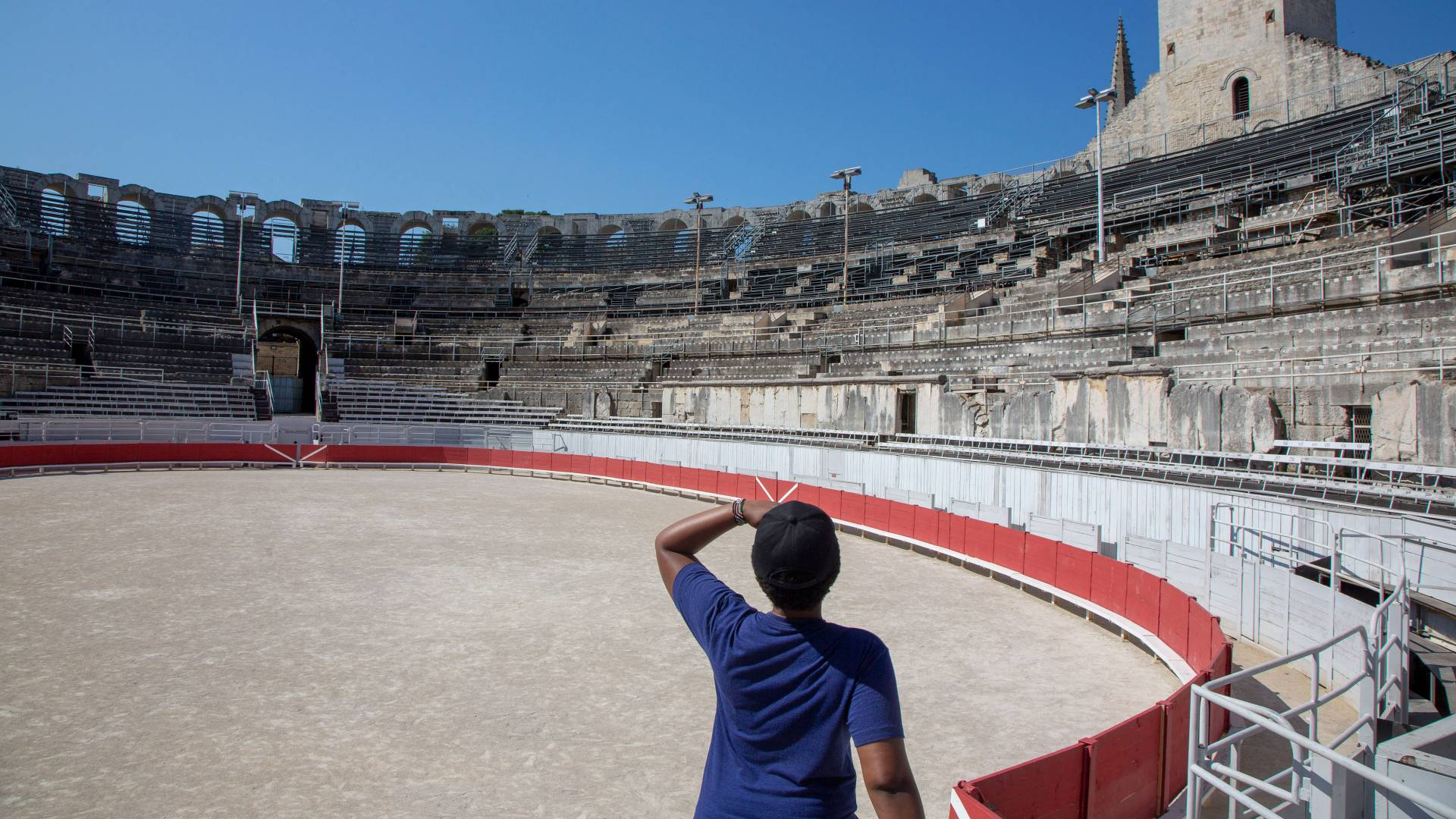 Student looking at amphitheater in Arles, France
