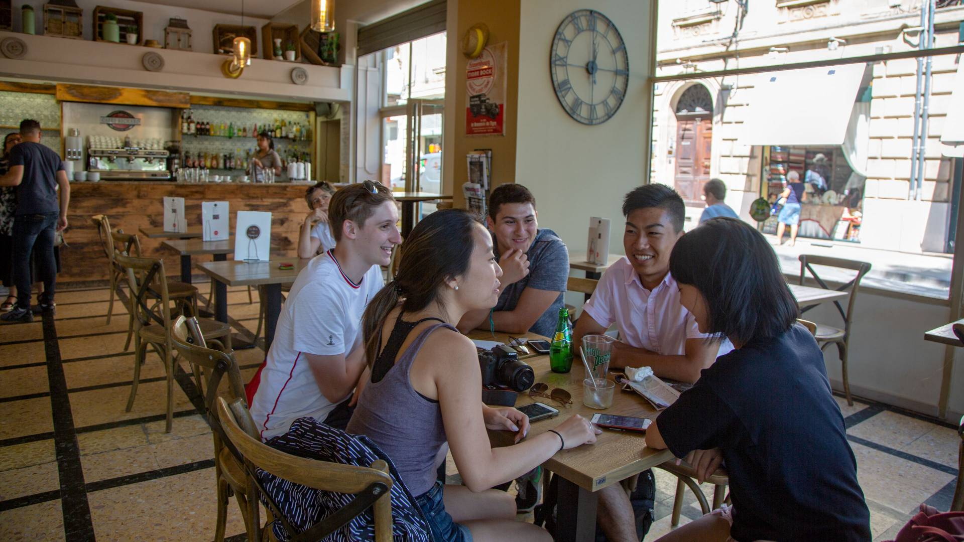 Students eating at a cafe in Arles, France