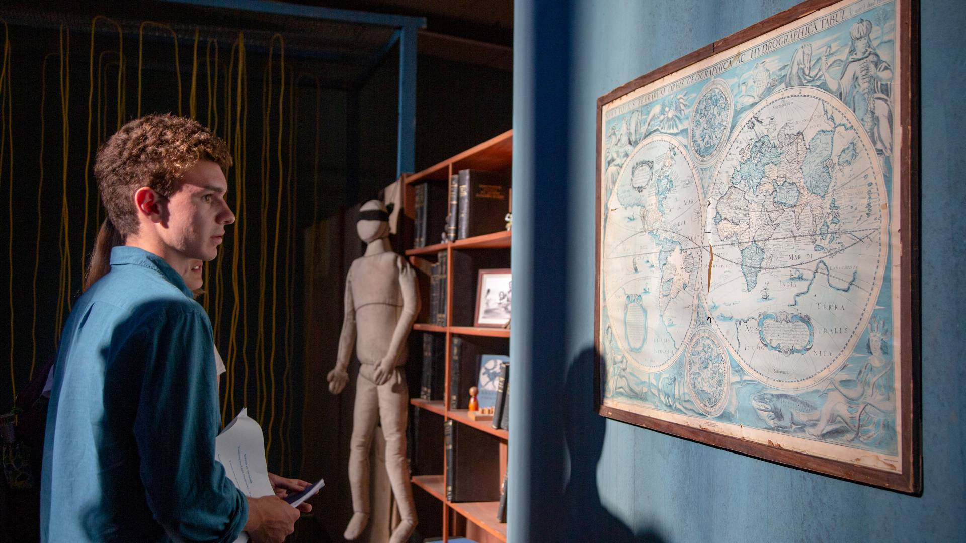 Students looking at ancient map in art installation in Athens, Greece