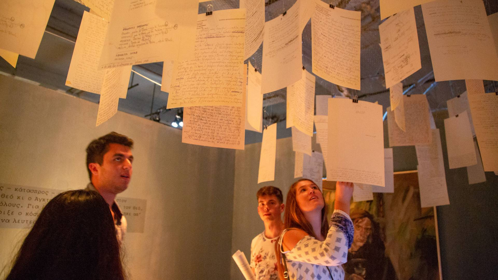Students looking at art installation in Athens, Greece