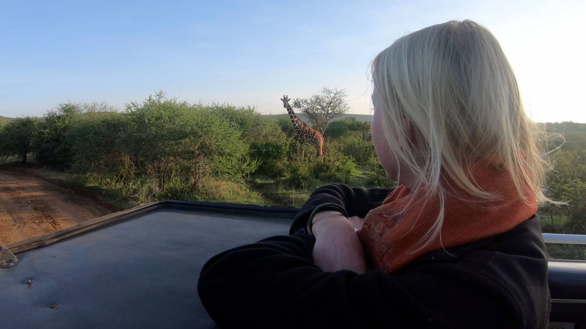 Zoe Sims watching giraffe at Mpala in Kenya