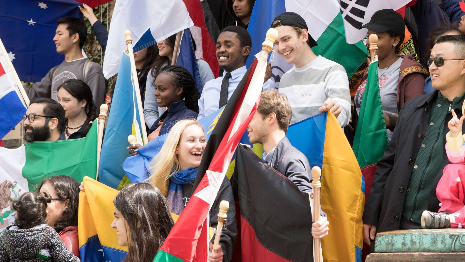 International students on the front steps of Nassau Hall
