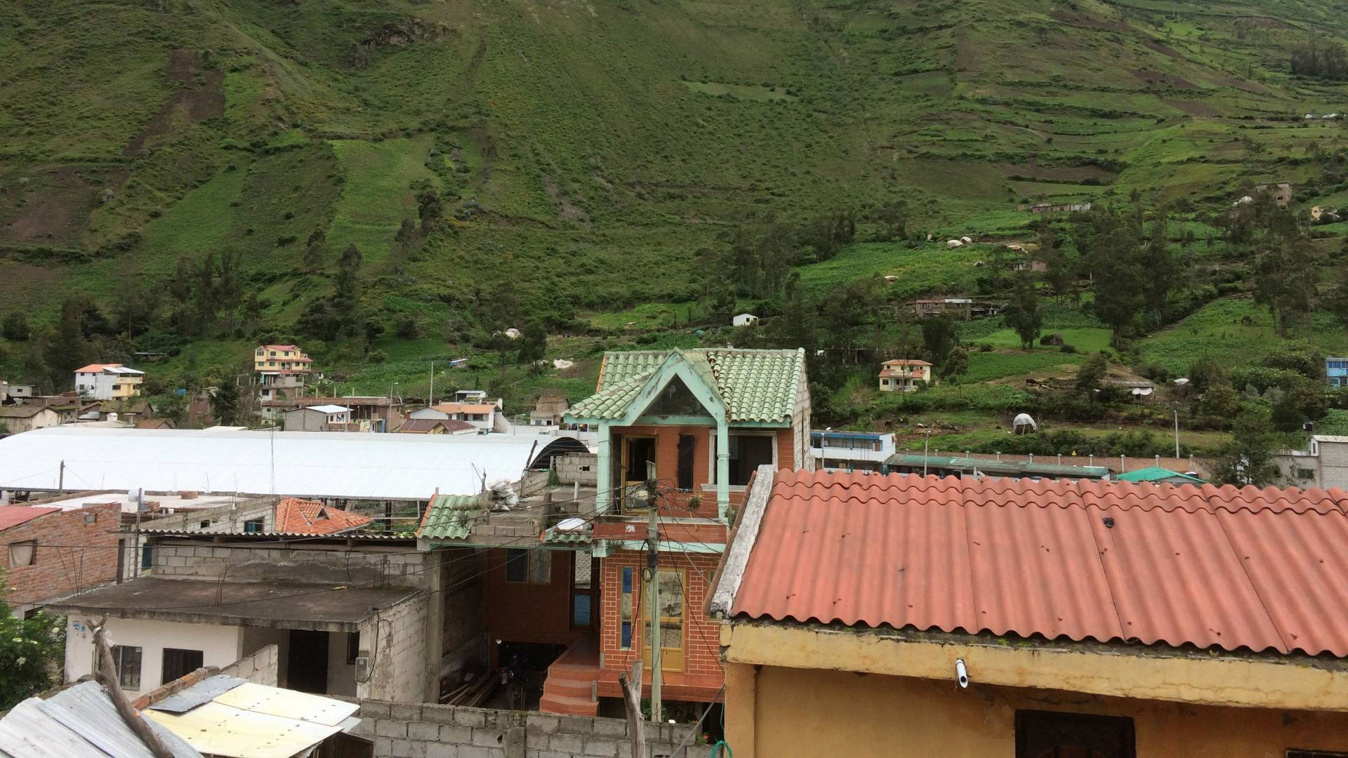 Rooftops and mountain in background in Ecuador