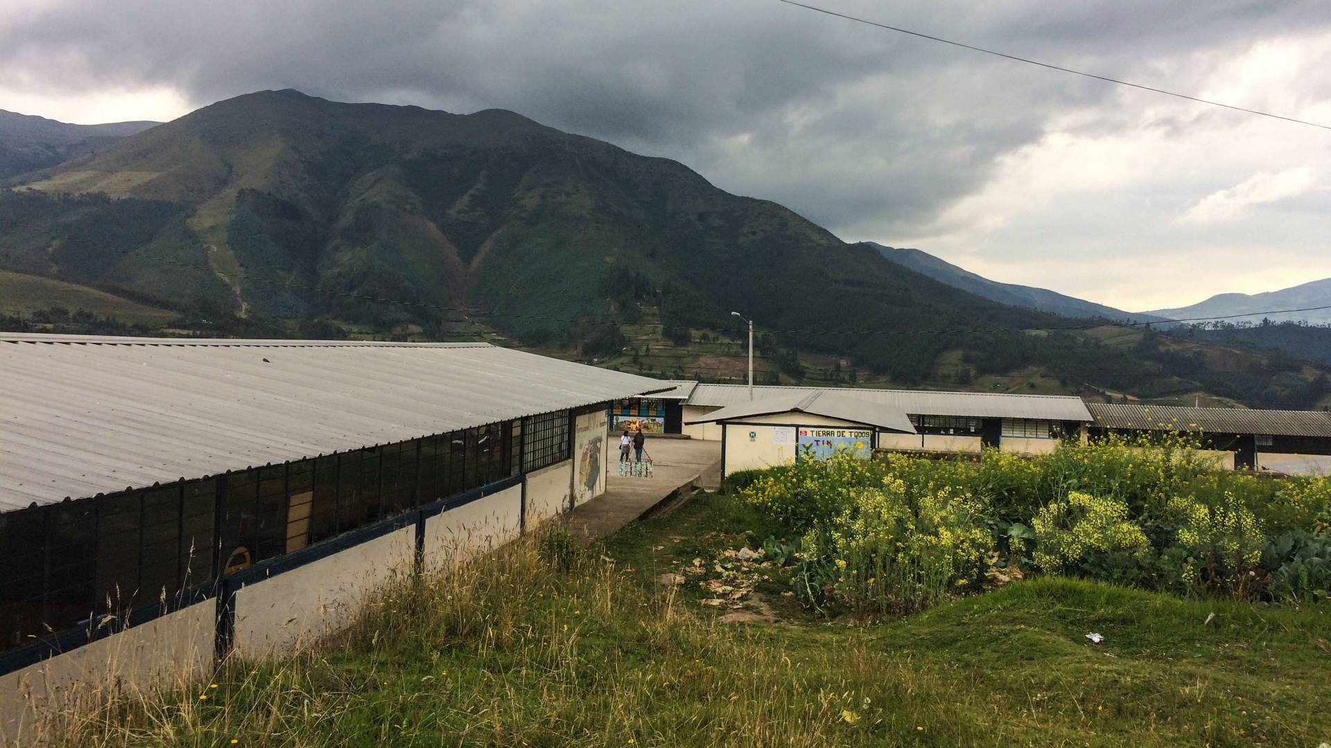 School building with mountains in background in Ecuador