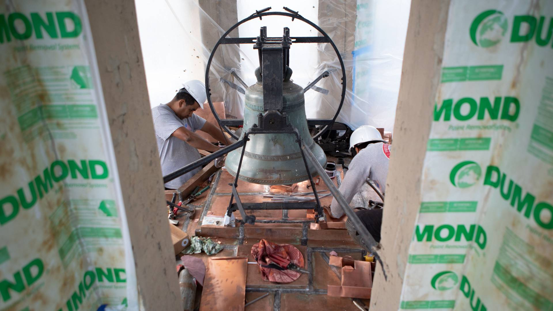 Workers working on bell in Nassau Hall cupola