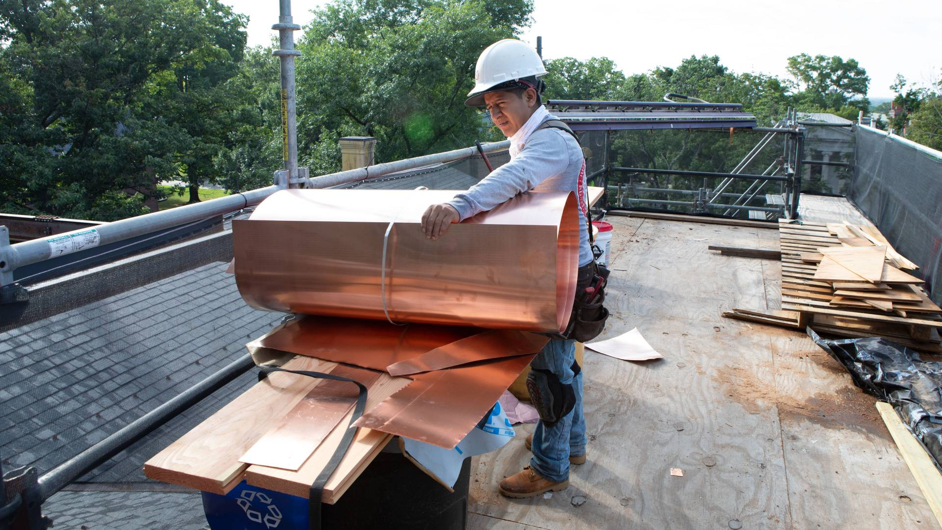 Working handling copper sheets on Nassau Hall cupola