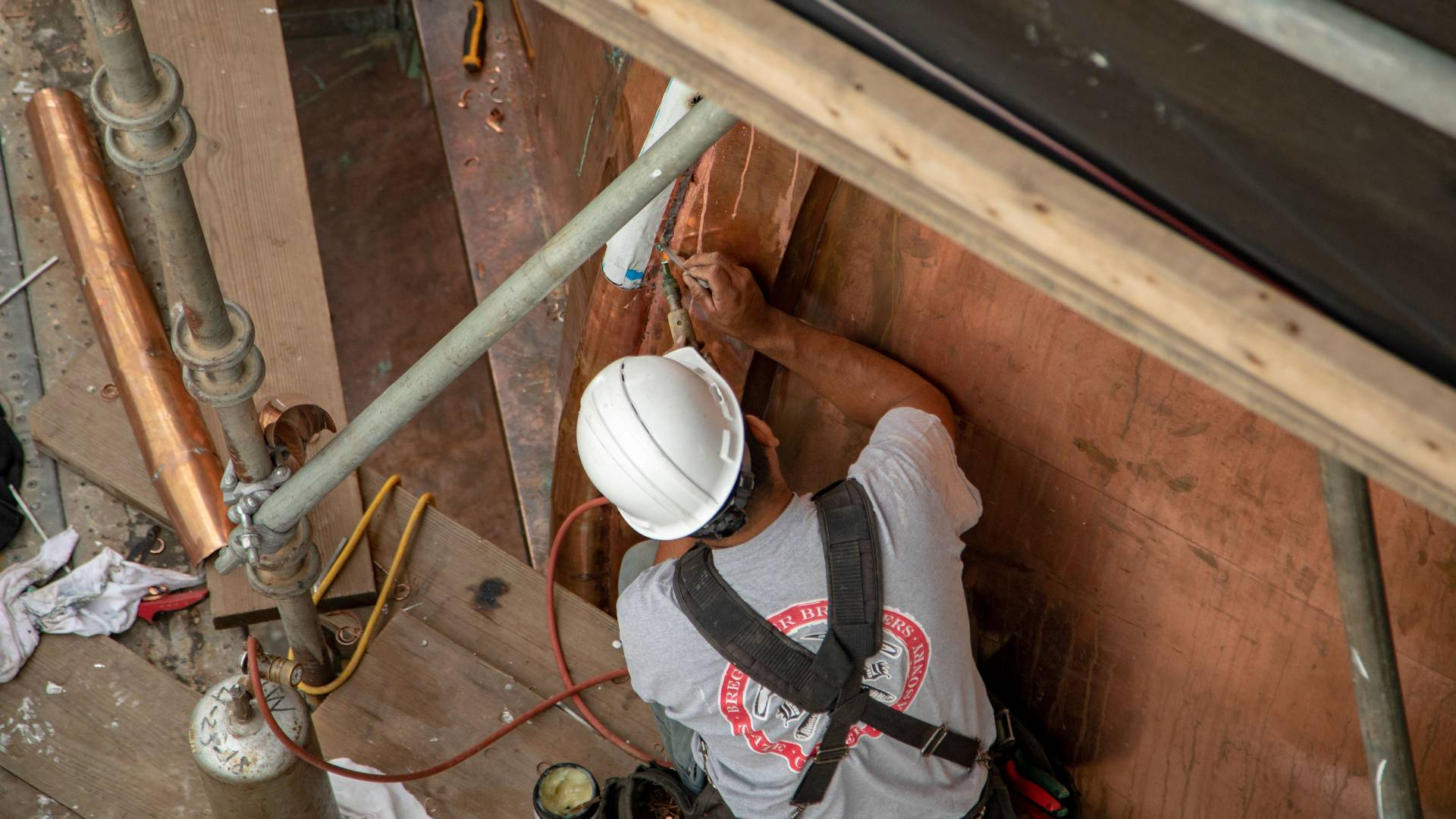 Worker soldering part of Nassau Hall cupola