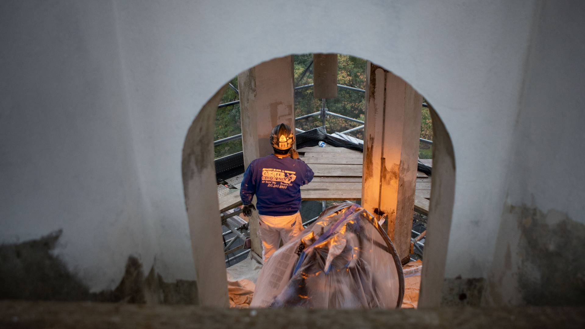 Worker painting interior of Nassau Hall cupola