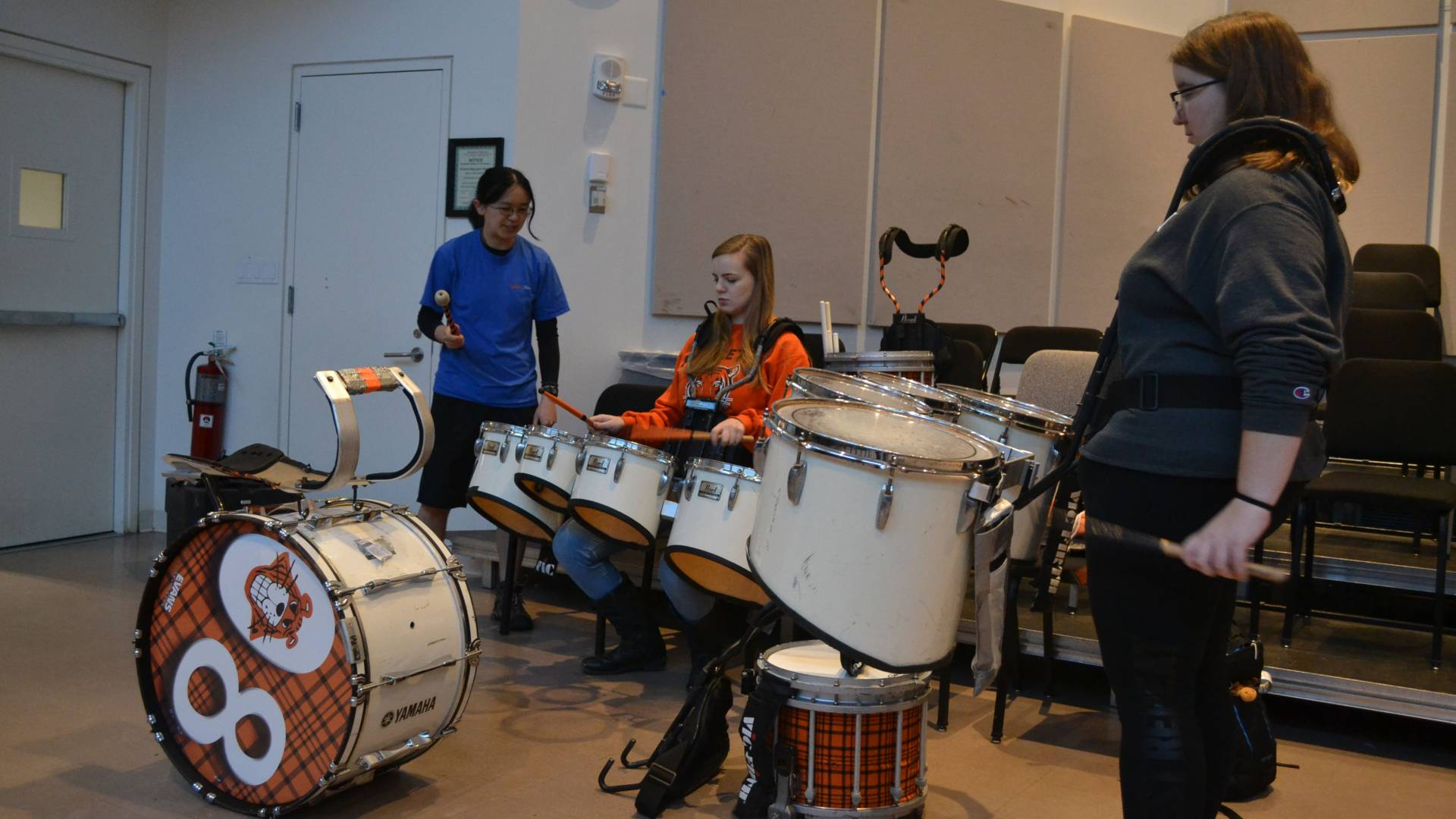 Students at the drums during Learn to Play an Instrument with the Band class