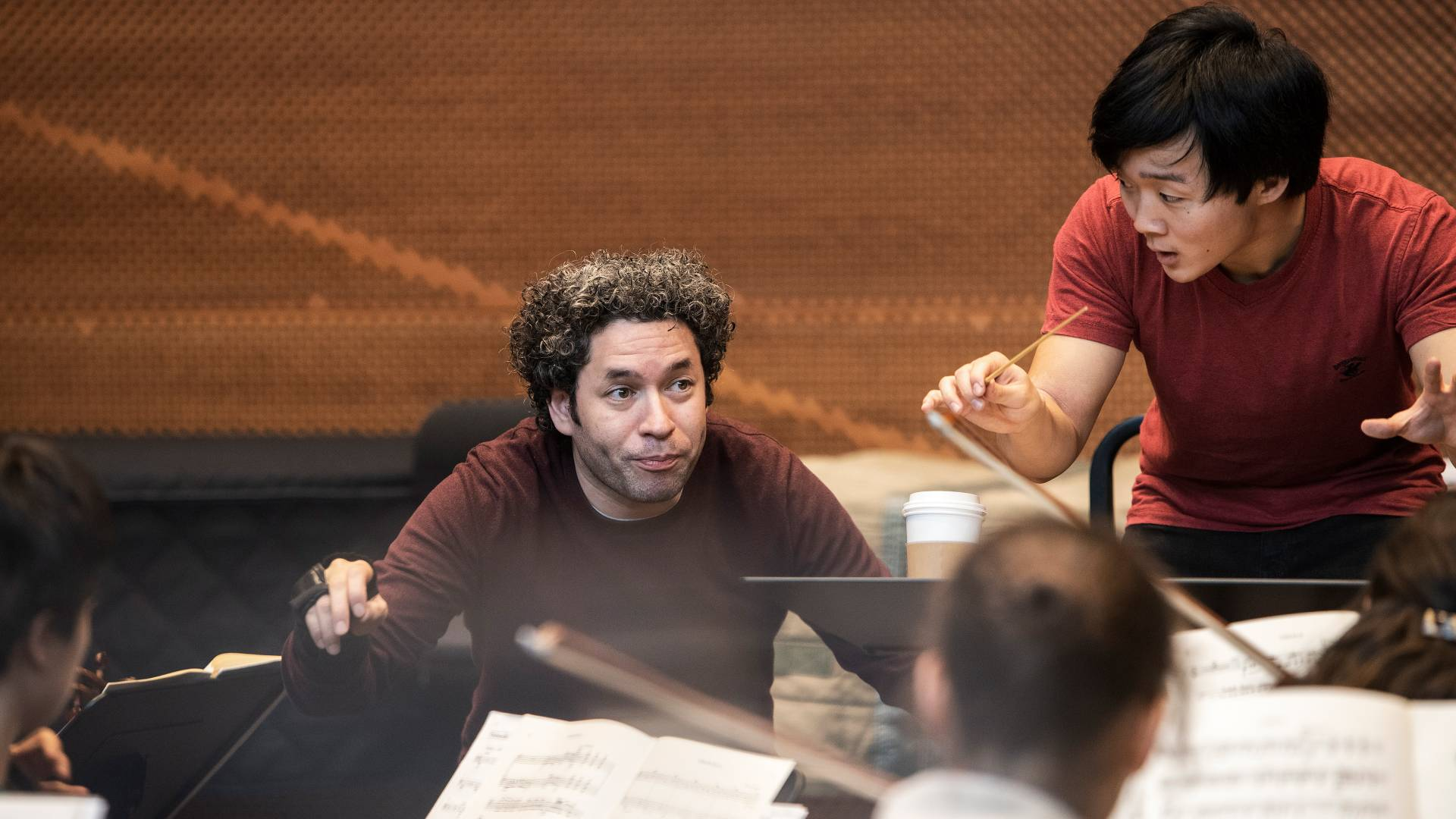 Gustavo Dudamel and Lou Chen conducting orchestra