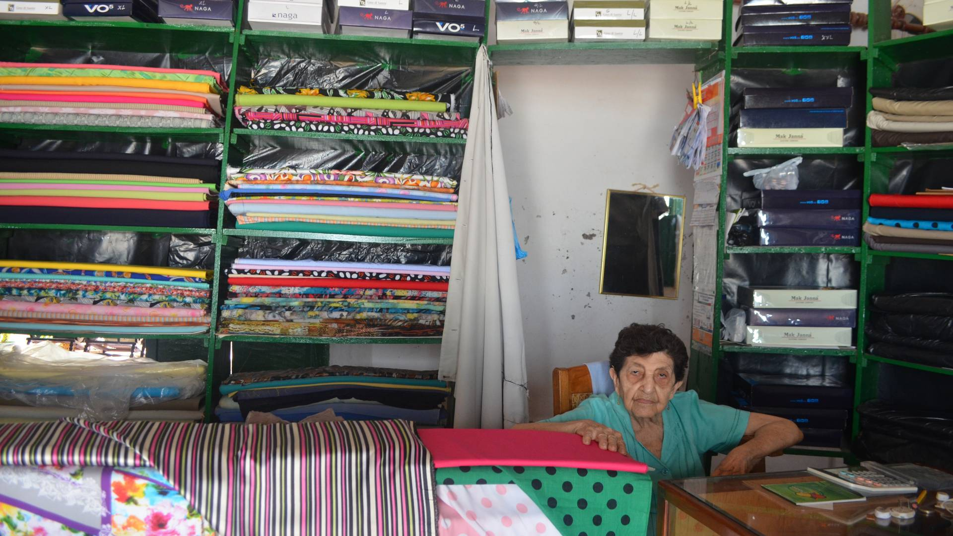 Woman sitting in fabric shop