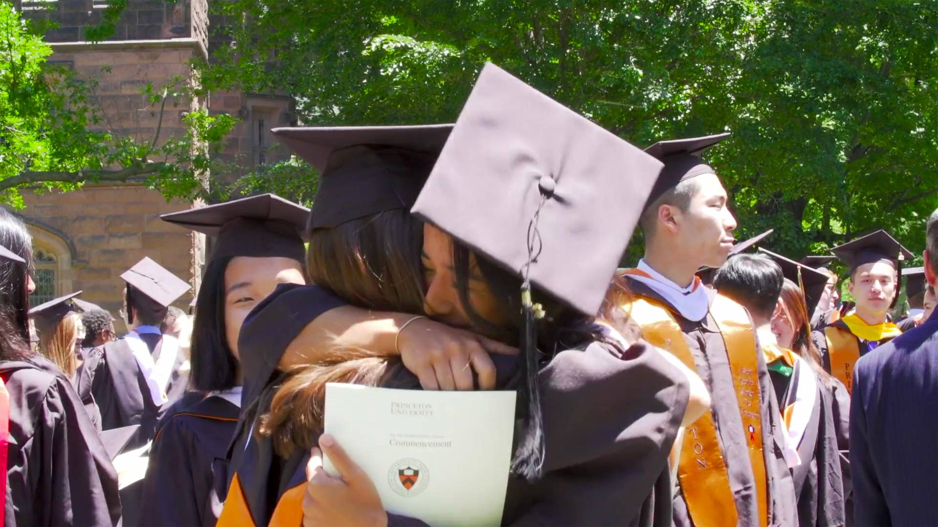 Graduating students hug