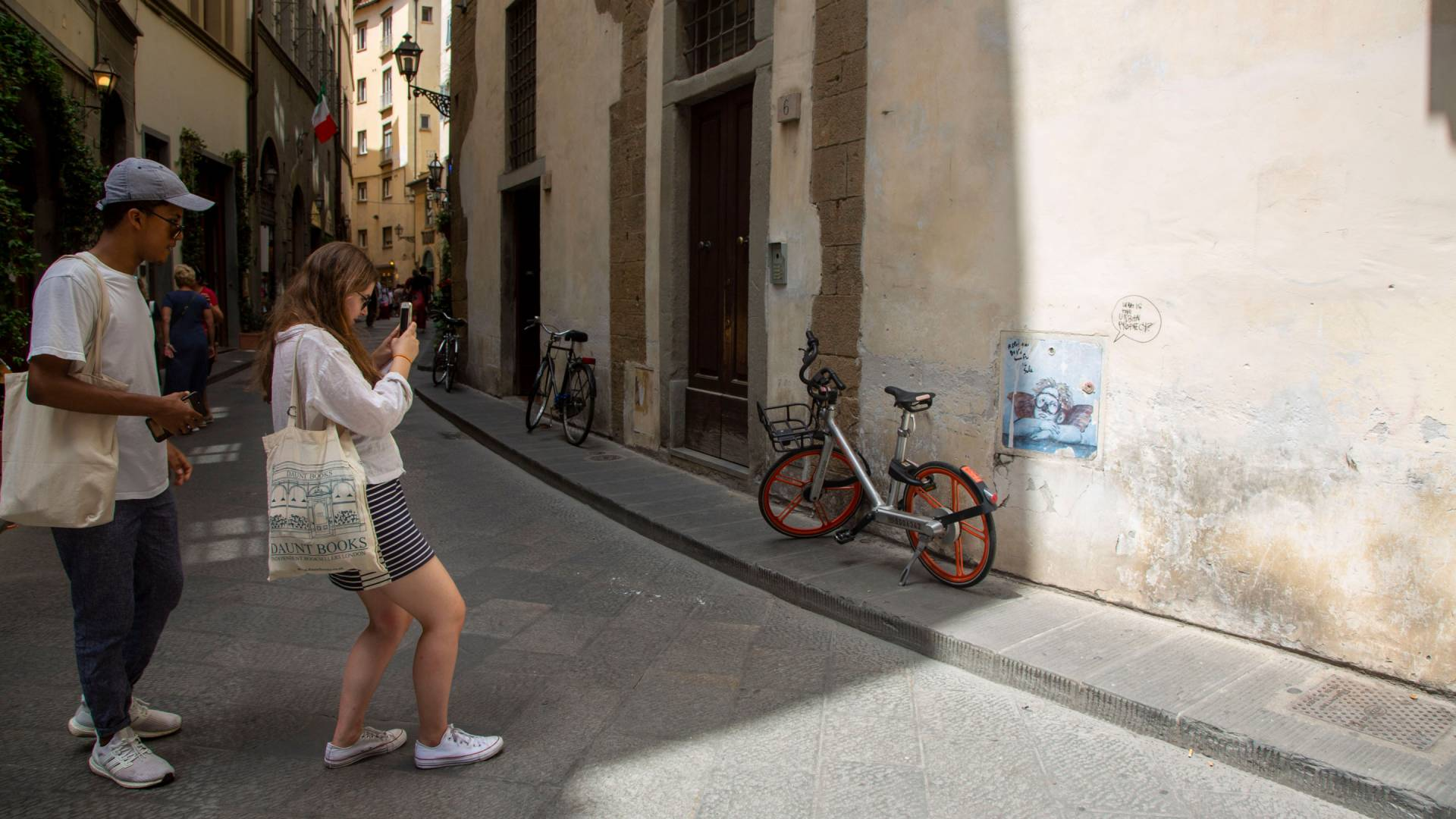 Students take photos of graffiti in Florence