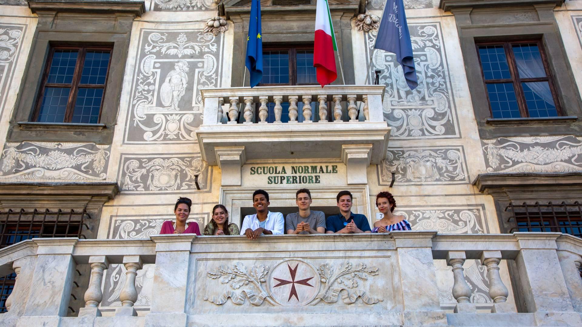 Students standing atop the steps of the Scuola Normale