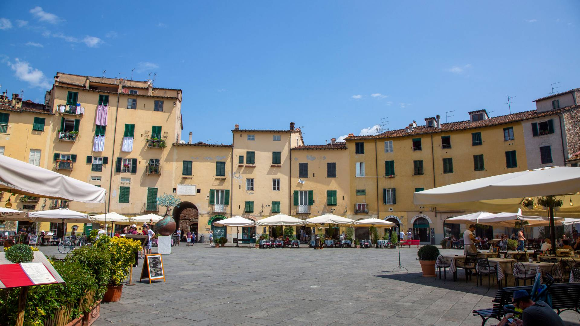 Square in Lucca surrounded by buildings