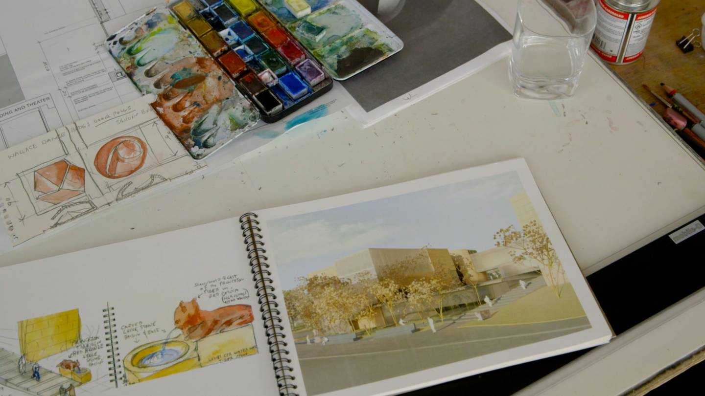 Architectural sketches, water color paints and drawings on table