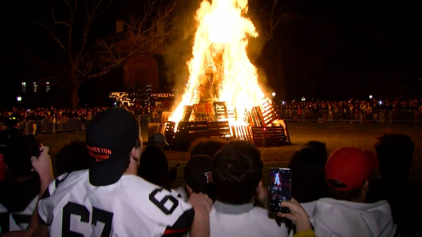 Students look on at the bonfire