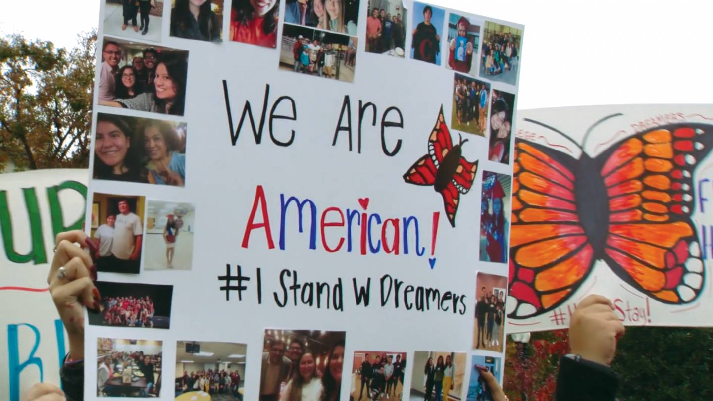 "protest sign reading, ""We are American. #IStandwDreamers"""