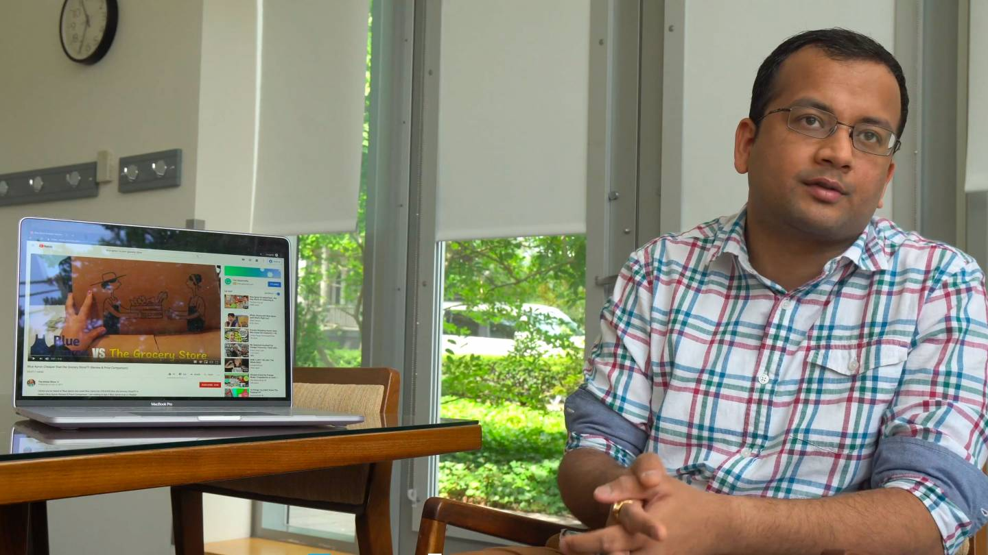 A graduate student while showing advertising on a laptop screen