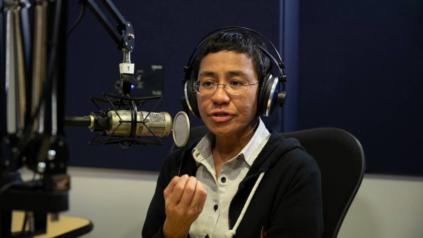 Maria Ressa is interviewed in a sound booth