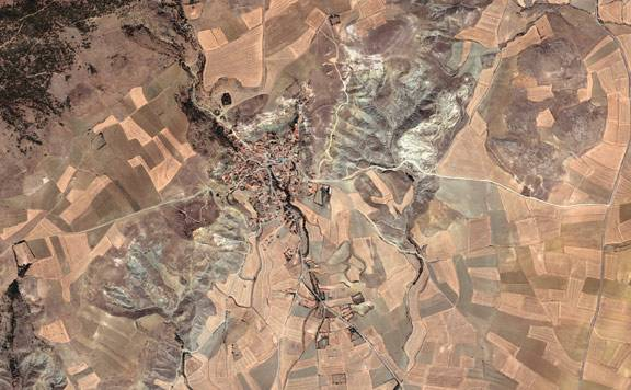 A Quickbird satellite image taken in July 2007 shows the village of Beyözü and its surrounding landscape