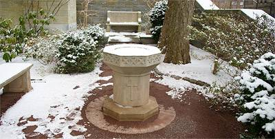 snow covered birdbath in garden