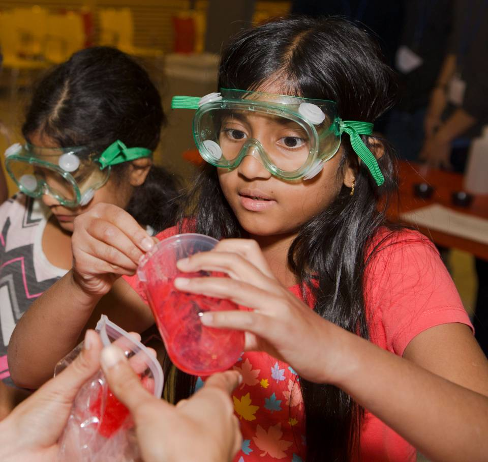 Children making slime at Chemistry Rocks event
