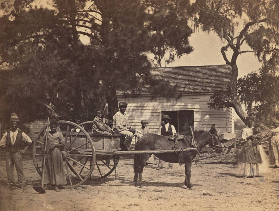 Old photograph of family with horse and cart