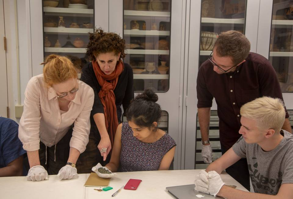 Faculty and students looking at ancient artifacts at Art Museum